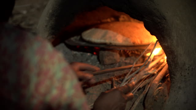 moroccan flatbread in oven woman tending fire - wiese stock videos & royalty-free footage