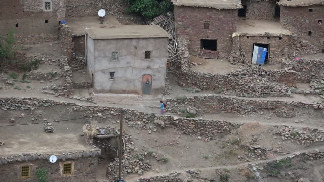 moroccan girl walking road r-l high shot - wiese stock videos & royalty-free footage