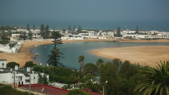 stockvideo's en b-roll-footage met moroccan high wide view of oualidia w shoreline pan - wiese