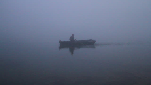 moroccan man in rowboat paddling in pre-dawn - wiese stock videos & royalty-free footage