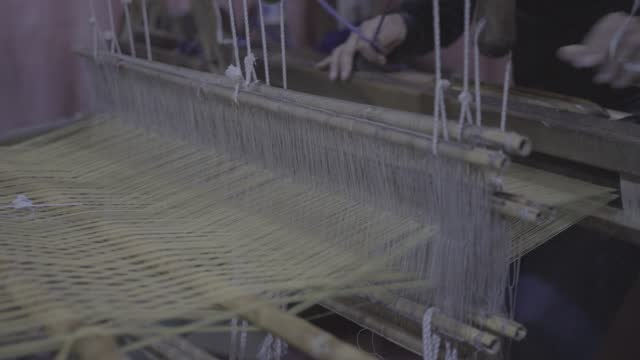 moroccan man weaving cloth on old machinery - editorial stock videos & royalty-free footage