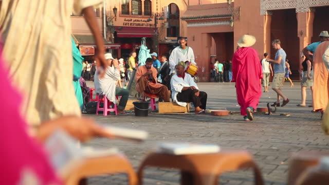 Moroccan musicians playing in DJAMMA EL FNA