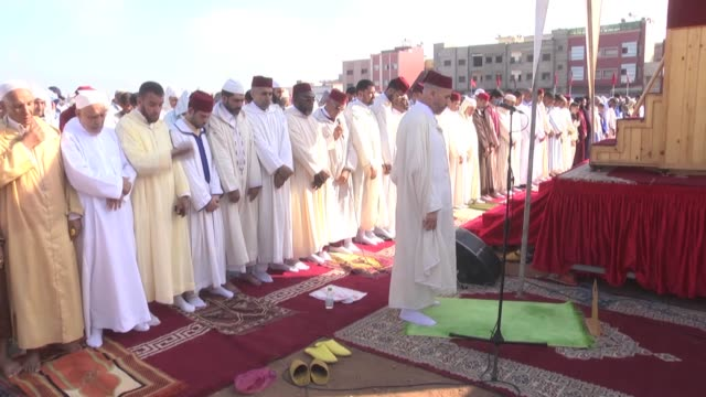 moroccan muslims perform eid alfitr prayer on the first day of threeday eid alfitr festival marking the end of the holy fasting month of ramadan on... - eid mubarak stock videos & royalty-free footage