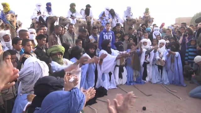 moroccan nomad men play sand hockey on the last day of the 14th international nomads festival in m'hamid el ghizlane town of zagora region, morocco... - last day stock videos & royalty-free footage