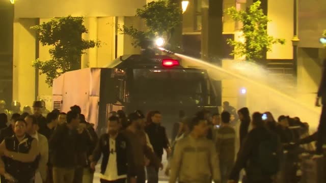 Moroccan police use water cannon to disperse a demonstration in Rabat by thousands of contract teachers protesting over their employment terms