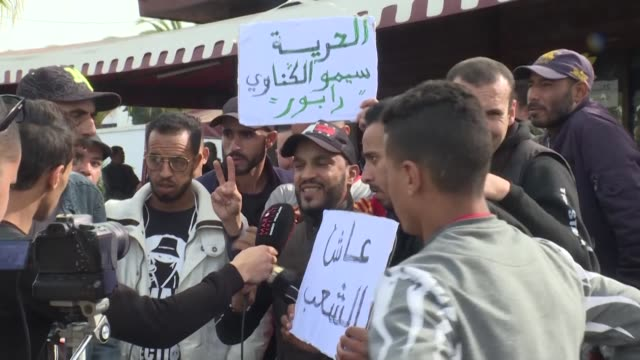 stockvideo's en b-roll-footage met moroccan rapper gnawi co author of a controversial track about the desperation of his countrys youth appeared before court in sale near rabat for... - sale
