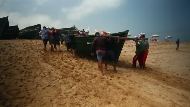 moroccan rowboat being carried ashore - wiese stock videos & royalty-free footage