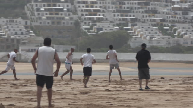 moroccan soccer on the beach - wiese stock videos & royalty-free footage