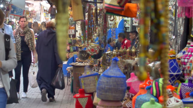 moroccan souk - colourful crafts on sale to tourists walking through the market - tourism stock videos & royalty-free footage