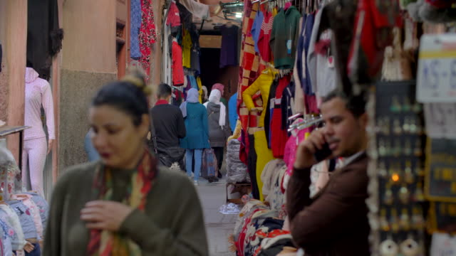 moroccan souk stall sells colourful trinkets to tourists reflecting north african berber and beduin crafts and culture - moroccan culture stock videos & royalty-free footage