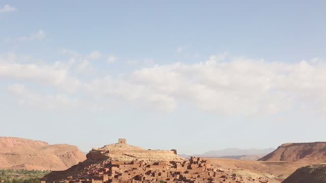 moroccan town built in hill tilt down - wiese stock videos & royalty-free footage