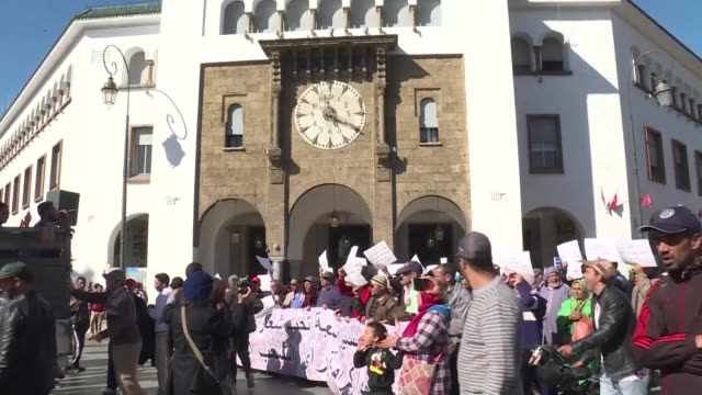Moroccans chant slogans and hold up anti government signs during a protest demanding dignity for the Moroccan people in the capital Rabat following a...