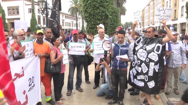 moroccans take part in a demonstration called by february 20 movement to protest alleged corruptions in front of the parliament building in rabat,... - parliament building stock videos & royalty-free footage