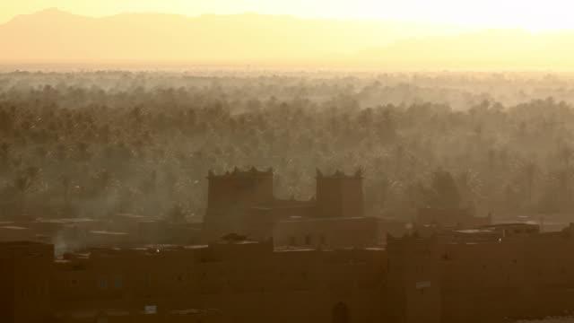 Morocco, near Zagora, Kasbah Ziwane near hotel Dar El Hiba. Sunrise over oasis.