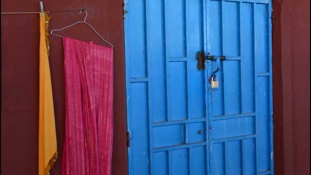 Morocco Sekoura small Berber village colorful blue door