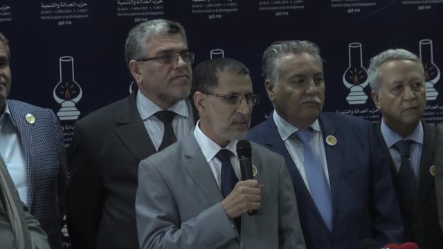 vidéos et rushes de morocco's new prime minister and head of justice and development party saad eddine el othmani speaks at a press conference next to aziz akhannouch... - socialisme