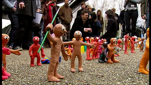 morph flash mob tribute to tony hart; england: london: tate modern: ext various close shots of plasticine figures of 'morph' outside tate modern art... - morphing stock videos & royalty-free footage