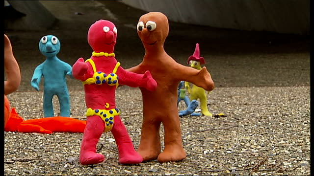 morph flash mob tribute to tony hart man dressed as morph / more of morphs - flash mob stock videos and b-roll footage