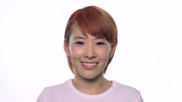 cu morph of 6 people dresssed in white t-shirts / london, uk - variation点の映像素材/bロール