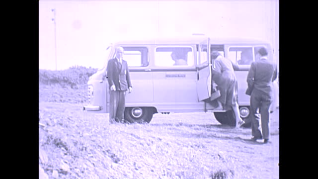 a morris commercial austen j2 minivan picks up passengers - guernsey stock-videos und b-roll-filmmaterial