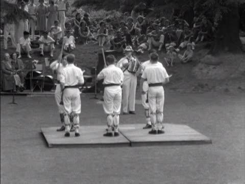 Morris dancers perform at a folk festival
