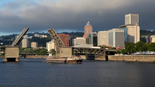 hd morrison bridge drawbridge with barge - bascule bridge stock videos and b-roll footage