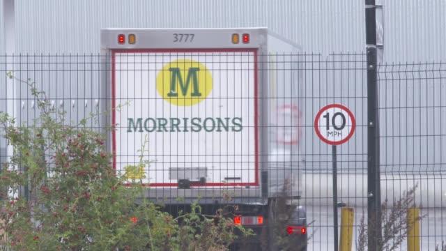morrisons distribution centre general views; england: kent: sittingbourne: ext / raining gv morrisons distribution centre with 'morrisons' signs on... - warehouse点の映像素材/bロール
