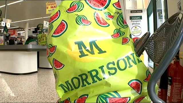 Morrisons supermarket announces restructuring after record losses ENGLAND West Midlands Birmingham INT Various of food goods being scanned at...