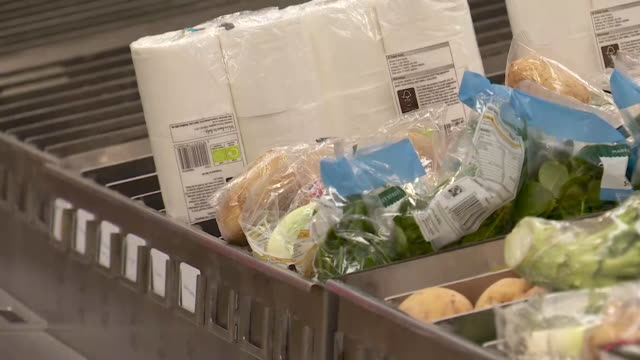 morrisons supermarket warehouse packing up basic food parcels during the coronavirus pandemic - packing stock videos & royalty-free footage