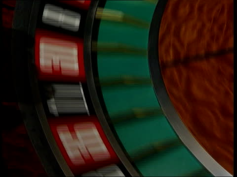 london ball rolling round spinning roulette table in casino ext seq kevin douse working in garden kevin douse interviewed sot i know of no other... - roulette stock videos & royalty-free footage