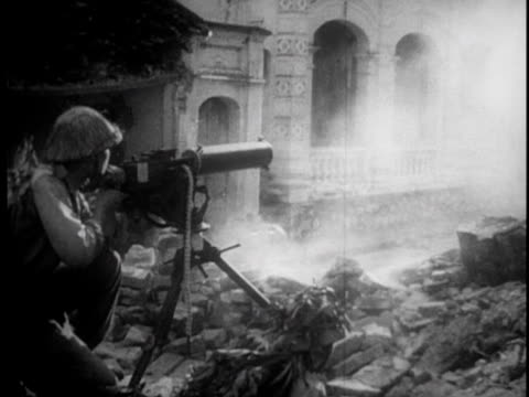 mortars are fired in urban combat setting / machine guns fire and troops race through rubble - indochina stock videos and b-roll footage