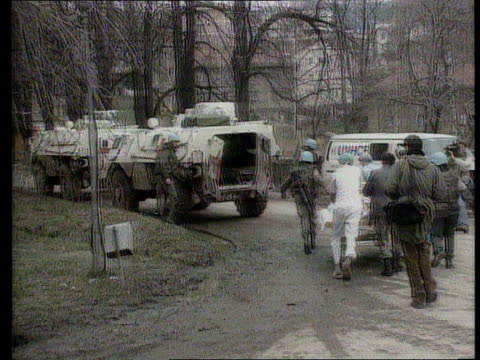 morter massacre aftermath; tx.16.7.92/itn bosnia-herzegovina seq doctors rushing about with wounded on stretchers - bosnian war stock videos & royalty-free footage