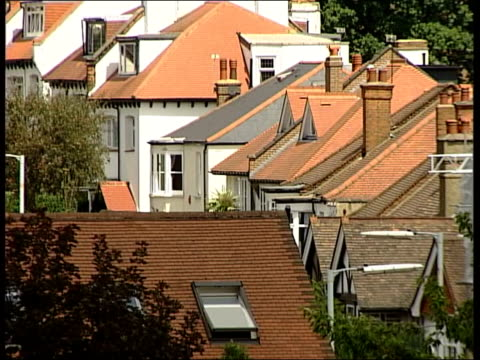 Mortgage lenders call for rate rise to slow house prices ITN MONTAGE of shots of rooftops of houses CS Button on electric kettle switching to 'off'...
