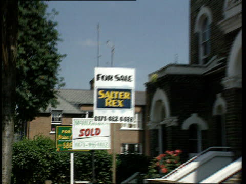mortgage rate cut ext london ms for sale signs by houses pull out ditto c02099201 gv street with terraced housing and for itn sale signs - for sale englischer satz stock-videos und b-roll-filmmaterial