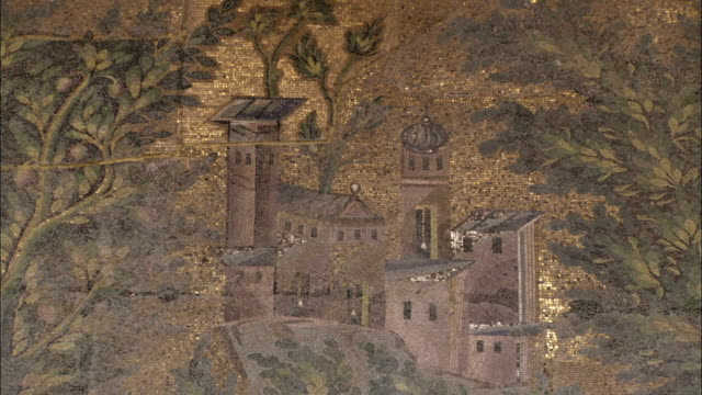 A mosaic depicts flowers buildings and trees in the Umayyad Mosque Damascus. Available in HD.