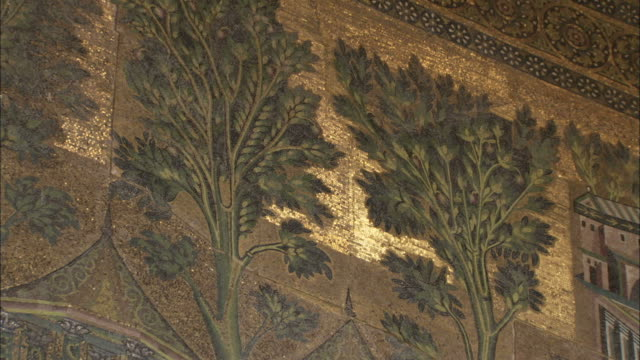 A mosaic frieze in the Umayyad Mosque courtyard depicts temples trees buildings and a river. Available in HD.