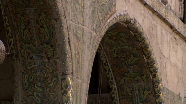 Mosaics cover the arches in the Umayyad Mosque courtyard. Available in HD.