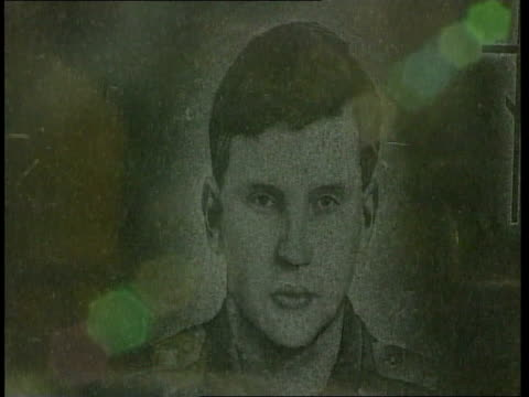 Moscow EXT CMS Gravestone of soldier killed in Chechnya TILT Another ditto Portrait of soldier on gravestone CS Snow on flower Gravestone of soldier...