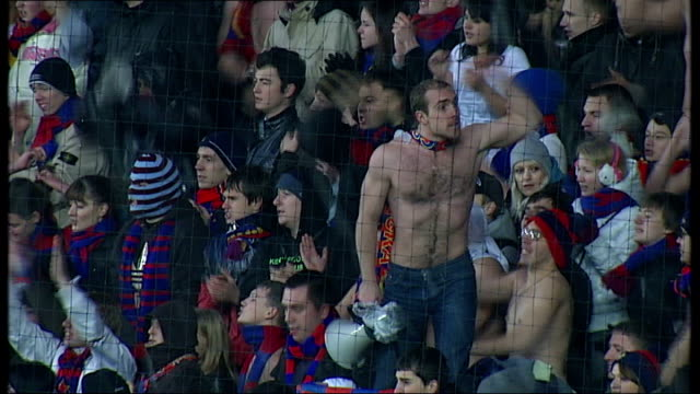 vidéos et rushes de football fans letting off flares in stands at moscow derby football match gv full stadium russian flag on flagpole gv stand full of fans topless... - fédération de russie