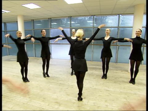 gzhel dance academy performers training general views of women dancers dancing / general views of dancers doing stretching exercises at the barre - barre stock videos and b-roll footage