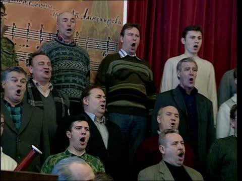 red army choir rehearsing a song sot luzhniki stadium: ext/snow i/c music overlay gv luzhniki stadium gv medal winners names cms sebastian coe's name... - choir stock videos & royalty-free footage