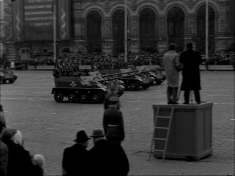 Moscow Pan Red Square Military parade / MS Troops marching / TS Crowds watching / Tanks past in parade / MS Ditto dust / MS Giant tanks with guns...