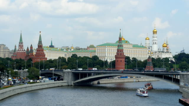 Moscow River with tourist boats and Kremlin towers/ Moscow, Russia