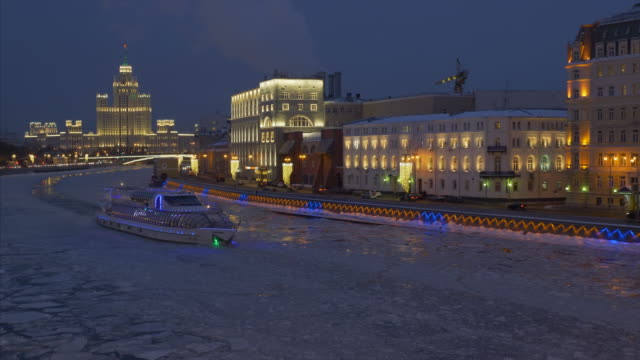 moscow russia city view at night on river with drifting ice, and stalin's high building - moscow russia stock videos and b-roll footage