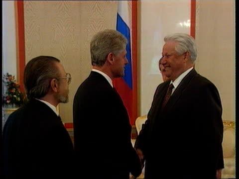 russian federation / usa summit: deadlock:; d)nao russian federation: moscow: kremlin: st katherine's hall: int boris yeltsin along r-l as shakes... - boris yeltsin stock videos & royalty-free footage
