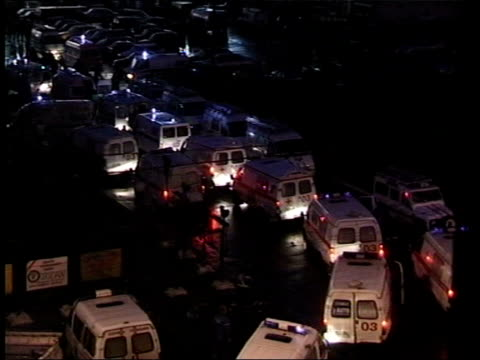 crime/ conflict moscow siege theatre stormed ext at night police on street as ambulances past tgv ambulances with flashing lights at site of siege 2... - belagerung stock-videos und b-roll-filmmaterial