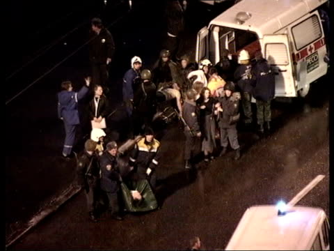 CRIME/ CONFLICT Moscow siege theatre stormed ITN RUSSIAN FEDERATION Moscow TS Emergency workers putting body of unconscious hostage onto stretcher at...