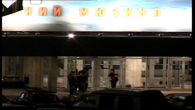 CONFLICT/ CRIME Moscow theatre siege aftermath LIB RUSSIA Moscow EXT / NIGHT Russian soldiers outside theatre where Chechen rebels held theatregoers...