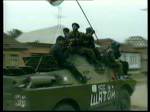 hundreds held by chechen gunmen lib chechnya chechen separatist fighters celebrating as along on military vehicles - belagerung stock-videos und b-roll-filmmaterial