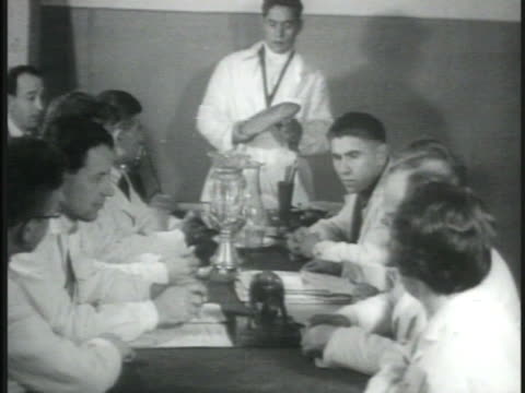 dramatization moscow ussr central committee meeting w/ male standing showing loaf of bread to other committee members communism russia - 1935 stock videos & royalty-free footage